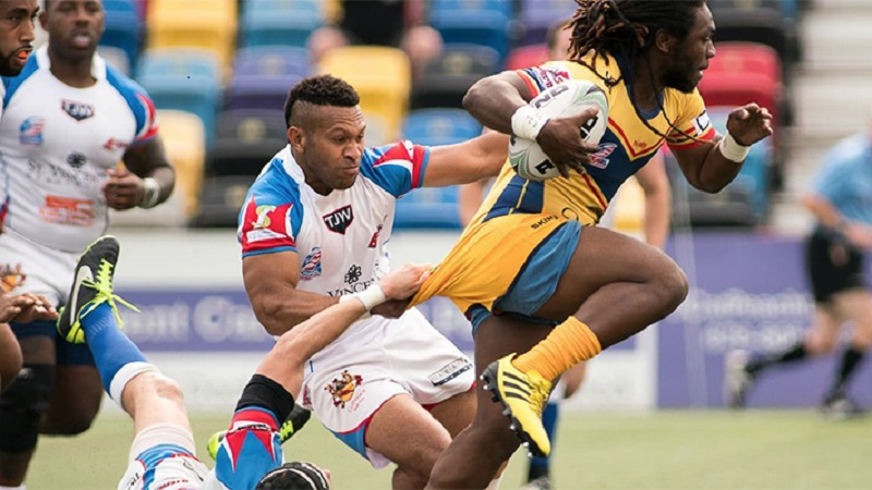 Rhinos Open Title Defense with Solid Win